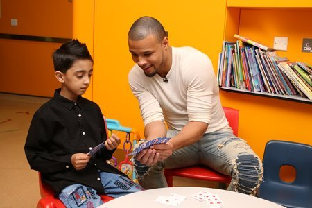Chris plays a game of cards with heart patient Abuzar